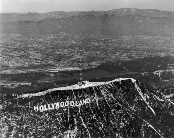 """<p>It wasn't until 1949 that <a href=""""https://www.hollywoodreporter.com/lists/hollywood-sign-turns-93-a-909365/item/hollywood-sign-landmark-909363"""" rel=""""nofollow noopener"""" target=""""_blank"""" data-ylk=""""slk:a lot went down"""" class=""""link rapid-noclick-resp"""">a lot went down</a> with the sign — literally. The """"H"""" fell and wasn't replaced for quite some time, but the Hollywood Chamber of Commerce ultimately decided to bring back the """"H"""" and remove """"Land."""" </p>"""