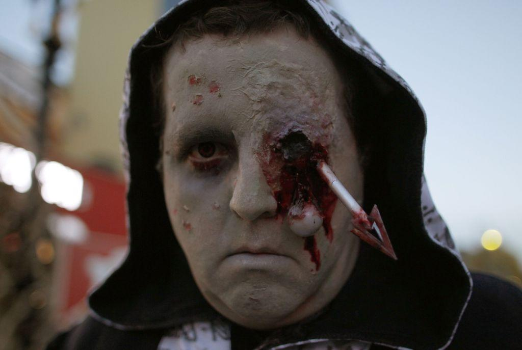 "A costumed performer poses during the ""Halloween Horror Party 2012"" at the Movie Park Germany in the western city of Bottrop."