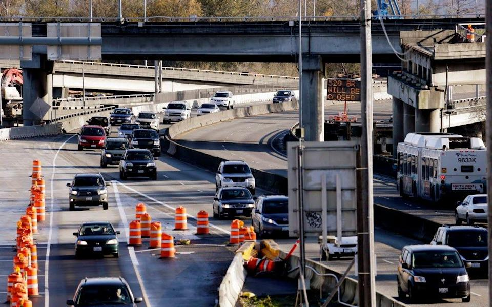 Traffic moves through a construction area on State Route 520 after crossing Lake Washington into Seattle on Nov. 19, 2015, in Seattle.