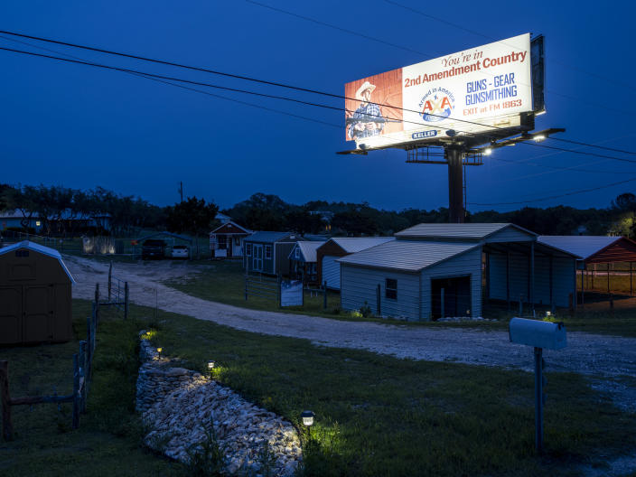 A billboard advertising guns and gun accessories in Blanco, Texas, May 27, 2021. (Matthew Busch/The New York Times)