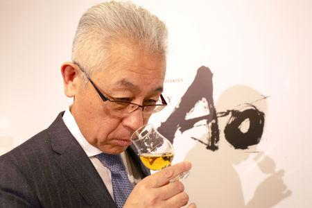 Suntory's chief blender Shinji Fukuyo smells Ao, Suntory's high-end world whisky, during its promotional event in Tokyo, Japan April 4, 2019. Picture taken on April 4, 2019. REUTERS/Ritsuko Ando