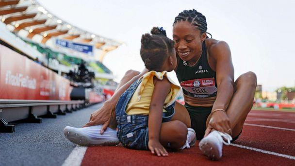 PHOTO: Allyson Felix celebrates with her daughter Camryn after finishing second in the Women's 400 Meters Final on day three of the 2020 U.S. Olympic Track & Field Team Trials at Hayward Field, June 20, 2021, in Eugene, Ore. (Steph Chambers/Getty Images)