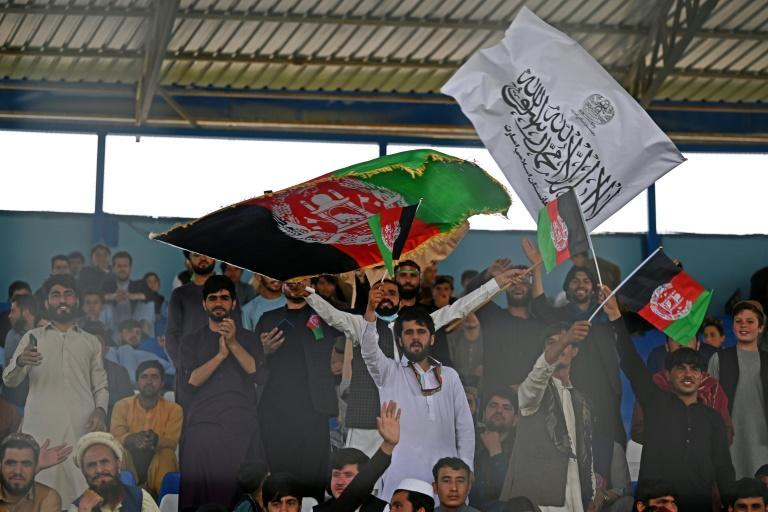 Taliban and Afghan flags waving side by side, in what officials said was a show of national unity (AFP/Aamir QURESHI)