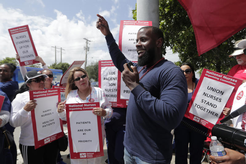 Nucleus Shelton of the AFL-CIO speaks to a group of nurses during a one-day strike outside of Palmetto General Hospital, Friday, Sept. 20, 2019, in Hialeah, Fla. Registered nurses staged a one-day strike against Tenet Health hospitals in Florida, California and Arizona on Friday, demanding higher wages and better working conditions. (AP Photo/Lynne Sladky)