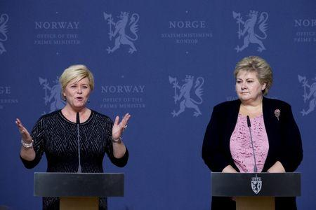 Norway's Finance Minister Siv Jensen speaks to the media next to Prime Minister Erna Solberg (R) in Oslo January 25, 2016.  REUTERS/Haakon Mosvold Larsen/NTB Scanpix