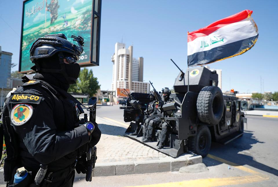 Members of the Iraqi Counter-terrorism Service (ICTS) are deployed in the streets of the capital Baghdad on March 27, 2021, days after a military parade by an armed faction loyal to Iran. (Ahmad Al-Rubaye/AFP via Getty Images)