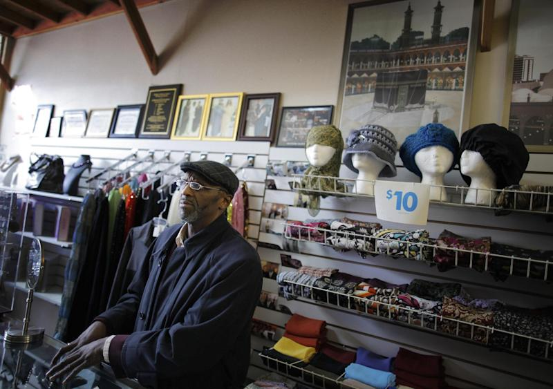 Imam Abdul A. Muhammad of the Masjid Imam K. Ali Muslim mosque in Newark, N.J., speaks in his clothing and accessories store regarding surveillance of the Muslim community by the New York Police Department, Wednesday, Feb. 15, 2012. Americans in New Jersey's largest city were subjected to surveillance as part of the New York Police Department's effort to build databases of where Muslims work, shop and pray. The operation in Newark was so secretive, even the city's mayor says he was kept in the dark. For months in mid-2007, plainclothes NYPD officers snapped pictures of mosques and eavesdropped in Muslim neighborhoods. The result was a 60-page report, obtained by The Associated Press. It cited no evidence of crimes. It was just a guide to Newark's Muslims. (AP Photo/Charles Dharapak)