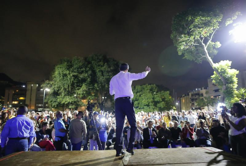 Venezuelan opposition leader and self-proclaimed interim president Juan Guaido speaks during a citizen's meeting in in Caracas, Venezuela, Wednesday, Nov. 13, 2019. Guaido is calling people across the crisis-torn nation to flood the streets for protests nearly a year since launching an urgent campaign to push President Nicolás Maduro from power. (AP Photo/Ariana Cubillos)