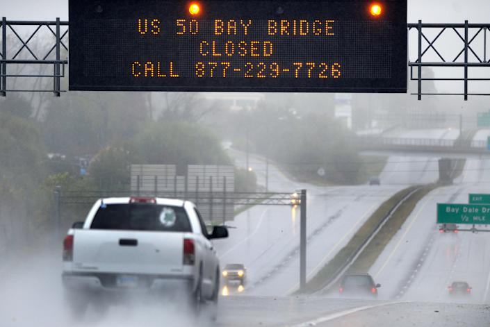 A sign informs motorists along U.S. Route 50 that Maryland's Chesapeake Bay Bridge, which connects the state's eastern and western shores, is closed because of winds from Hurricane Sandy Monday, Oct. 29, 2012. Hurricane Sandy continued on its path Monday, as the storm forced the shutdown of mass transit, schools and financial markets, sending coastal residents fleeing, and threatening a dangerous mix of high winds and soaking rain. (AP Photo/Steve Ruark)