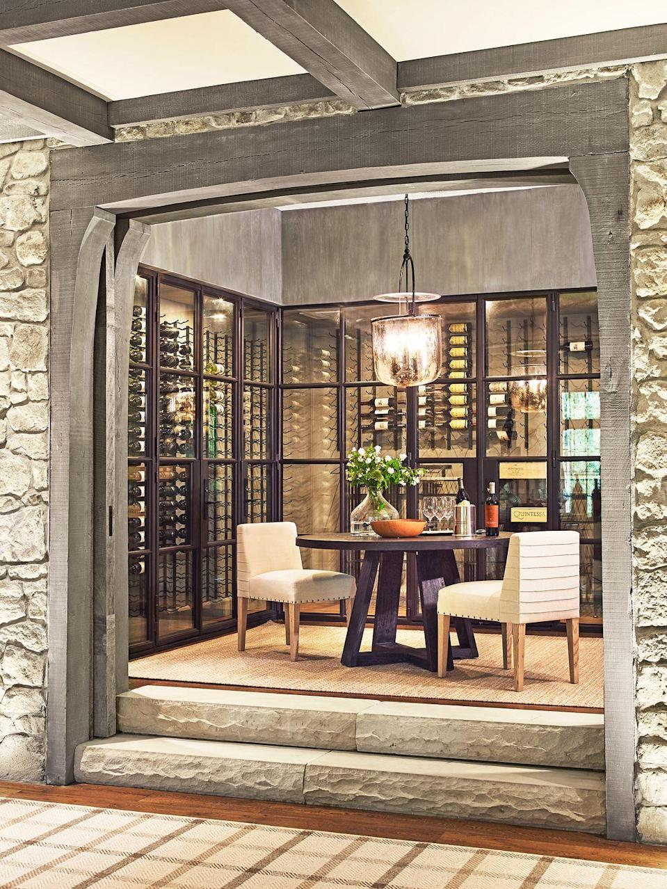 """<p>When designing a wine cellar you can also host guests in, it's best to keep wine behind glass in a climate-controlled zone and then use the rest of the useable space for a lounge area so you can keep both your wine and your guests comfy. Interior designer <a href=""""http://suzannekasler.com/"""" rel=""""nofollow noopener"""" target=""""_blank"""" data-ylk=""""slk:Suzanne Kasler"""" class=""""link rapid-noclick-resp"""">Suzanne Kasler</a> designed this wine room for<a href=""""https://www.housebeautiful.com/design-inspiration/a33538767/suzanne-kasler-tennessee-blackberry-farm/"""" rel=""""nofollow noopener"""" target=""""_blank"""" data-ylk=""""slk:clients who love hosting"""" class=""""link rapid-noclick-resp""""> clients who love hosting</a> (read: wining and dining) their large extended family. </p>"""