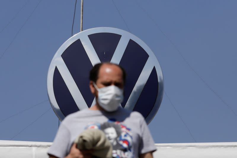 FILE PHOTO: An employee leaves the Volkswagen (VW) plant as the company will temporarily close its factories in Mexico amid growing worries over the spread of the coronavirus disease (COVID-19), in Puebla