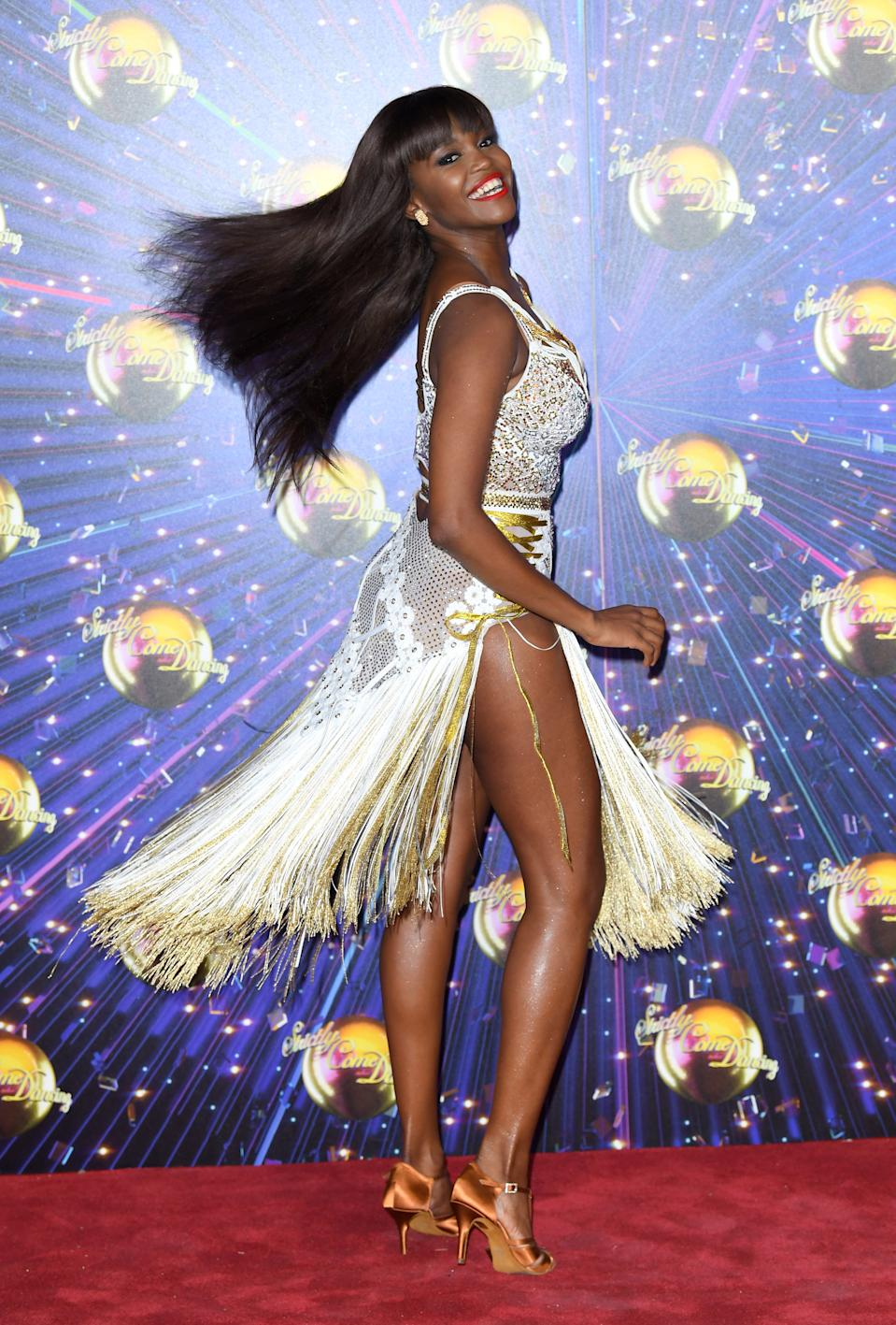 Reigning champ Oti Mabuse will be back on the dancefloor. (Photo by Karwai Tang/WireImage)