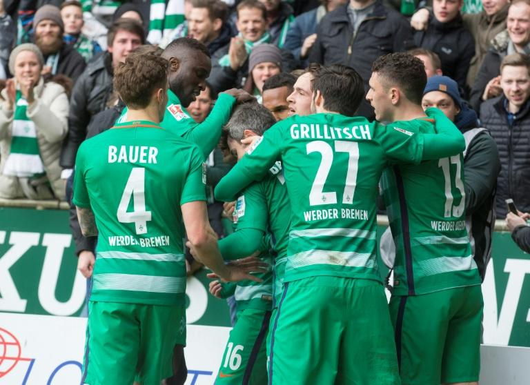 Werder Bremen's players react after scoring the first goal during the German First division Bundesliga football match March 18, 2017