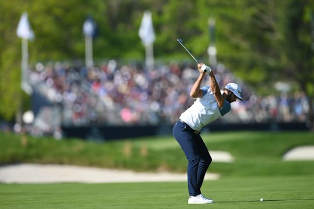 """<h1 class=""""title"""">PGA Championship - Round Two</h1> <div class=""""caption""""> FARMINGDALE, NEW YORK - MAY 17: <a class=""""link rapid-noclick-resp"""" href=""""/pga/players/9267/"""" data-ylk=""""slk:Dustin Johnson"""">Dustin Johnson</a> of the United States plays his shot on the 13th hole during the second round of the 2019 PGA Championship at the Bethpage Black course on May 17, 2019 in Farmingdale, New York. (Photo by Stuart Franklin/Getty Images) </div> <cite class=""""credit"""">Stuart Franklin</cite>"""