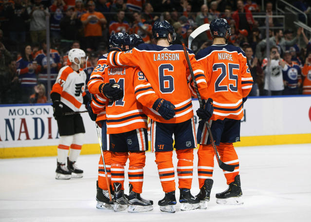Philadelphia Flyers' Andrew MacDonald (47) skates past as Edmonton Oilers players celebrate a goal during the second period of an NHL hockey game against the Edmonton Oilers, Friday, Dec. 14, 2018 in Edmonton, Alberta. (Jason Franson/The Canadian Press via AP)