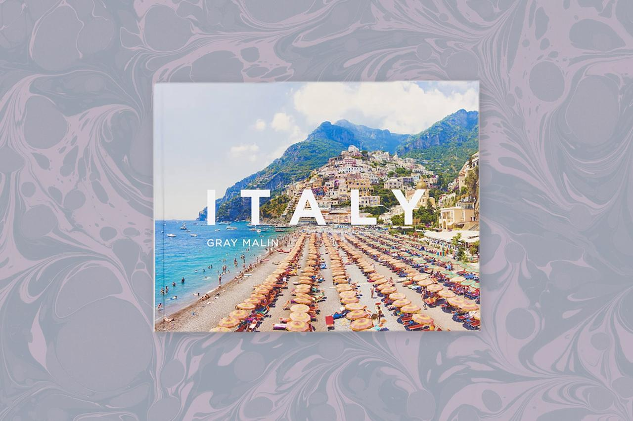 "<p>Aerial shots, pleasingly neat geometric patterns in the form of pinwheel-like umbrellas, and brilliant blue hues: You know Gray Malin when you see him. In <em>Italy</em>, the king of aesthetics showcases the photographs he took during summer visits to <a href=""https://www.cntraveler.com/package/secret-italy?mbid=synd_yahoo_rss"" target=""_blank"">the coast</a>. The pictured regions are scattered along the border of the boot—the Amalfi Coast, Capri, Cinque Terre, Lake Como, Puglia, Sicily, <a href=""https://www.cntraveler.com/story/a-guide-to-tuscan-wine-country?mbid=synd_yahoo_rss"">Tuscany</a>, and Portofino grace the glossy pages of this cheerful <a href=""https://www.cntraveler.com/story/the-coffee-table-books-to-give-and-keep-this-year?mbid=synd_yahoo_rss"">coffee table book</a>. Sunbathers on the hot white rocks of Grotta della Poesia, boats bobbing in the azure waters of Portofino harbor, and sun-bleached clouds above the seaside cliffs of Capri will give your imagination all it needs to make it through winter. In the introduction, Malin even likens Italy to an ice cream cone in July. Whether or not you find that analogy silly, the bright and beachy images that follow are certainly as enticing as it gets.</p> <p><strong>Buy Now:</strong> $40, <a href=""https://fave.co/2Y7DXLs"" rel=""nofollow"" target=""_blank"">anthropologie.com</a></p>"