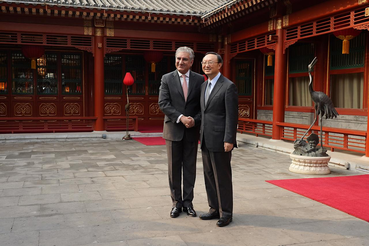 Chinese Director of the Central Foreign Affairs Commission Office Yang Jiechi shakes hands with Pakistani Foreign Minister Shah Mehmood Qureshi at Diaoyutai State Guesthouse on March 20, 2019 in Beijing, China. Andrea Verdelli/Pool via REUTERS