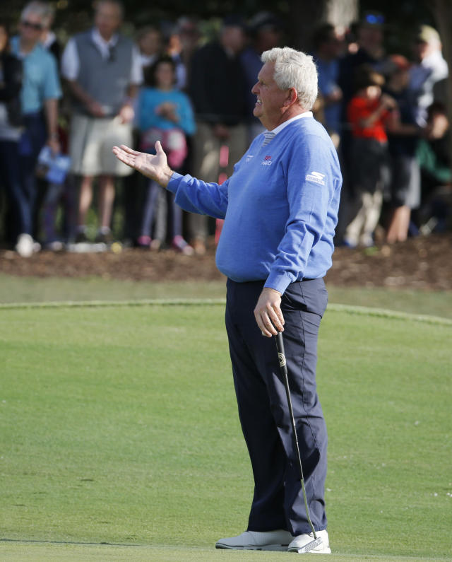 Colin Montgomerie gestures to noisy fans in the stands on the finishing hole during the second round of the PGA Tour Champions' Dominion Energy Charity Classic golf tournament in Richmond, Va., Saturday, Oct. 19, 2019. Montgomerie missed a birdie putt moments later that would have put him into a tie for the lead. ( Joe Mahoney/Richmond Times-Dispatch via AP)