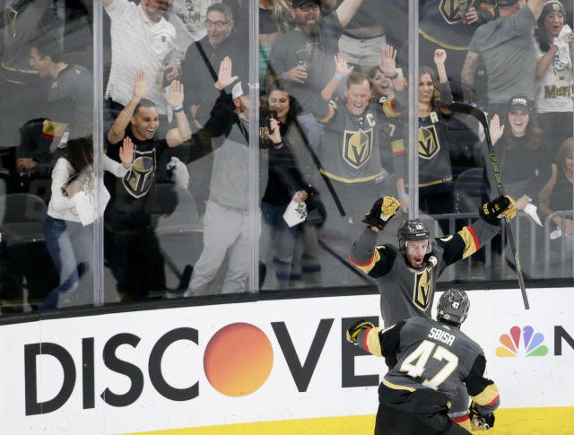 FILE - In this Friday, May 18, 2018, file photo, Vegas Golden Knights right wing Reilly Smith, back, celebrates his goal with Luca Sbisa during the third period against the Winnipeg Jets in Game 4 of the NHL hockey Western Conference finals in Las Vegas. The love affair between a city and its new team wasn't totally unexpected. Las Vegas was, after all, a town starved for major league sports. (AP Photo/Marc Sanchez, File)