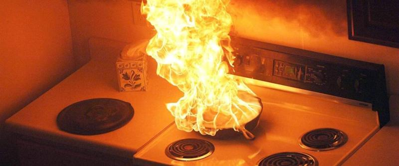 A fire in a pan of grease on a stove