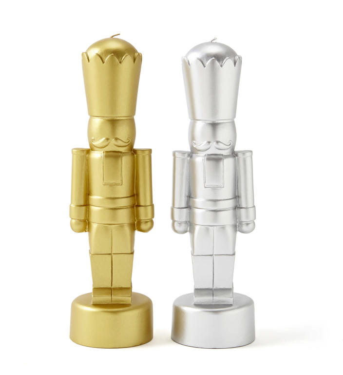 In this photo provided by JCPenney, stylized nutcrackers in gold and silver are actually candles, from Jonathan Adler's holiday collection. Following the general trend in home decor, holiday trim and accessories this year are a mix of eclectic and traditional colors and styles. Style watchers say we're approaching the holidays with a more open mind, and decor has never been more expansive in terms of what works. (AP Photo/JCPenney)