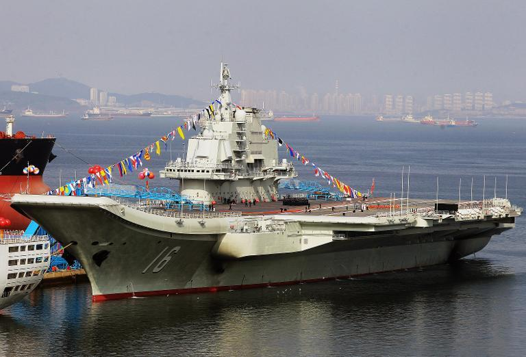 China's first aircraft carrier, a former Soviet carrier called the Varyag, docked after its handover to the People's Liberation Army navy in Dalian on September 24, 2012