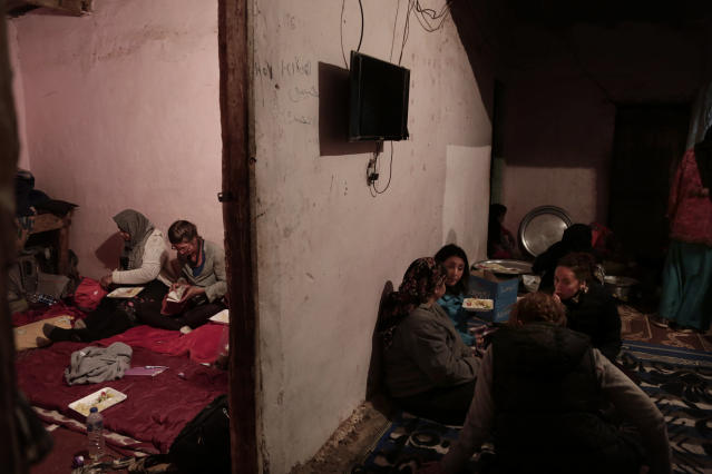 In this March 30, 2019 photo, women eat in Umm Yasser's home in Wadi Sahw, Abu Zenima, in South Sinai, Egypt. Four Bedouin women are for the first time leading tours in Egypt's Sinai Peninsula, breaking new ground in their deeply conservative community, where women almost never work outside the home or interact with outsiders. The tourists can only be women, and the tours can't go overnight. Each day before the sun sets, the group returns to the Hamada's home village in Wadi Sahu, a narrow desert valley. (AP Photo/Nariman El-Mofty)