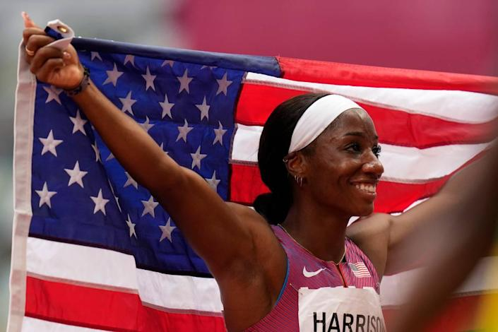 Former UK star Kendra Harrison, the world record holder in the event, celebrated after her second-place finish in the women's 100-meter hurdles at the Olympics.