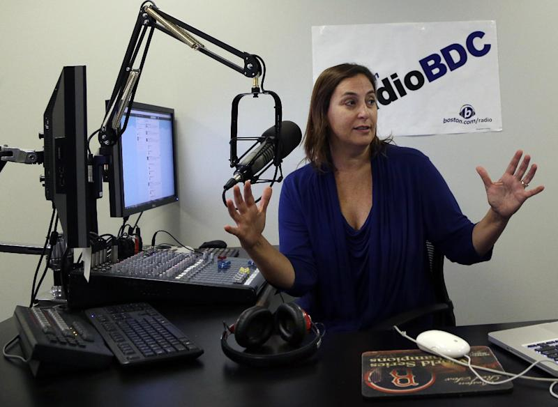"""In this Aug. 24, 2012 photo, disc jockey Julie Kramer broadcasts during her program """"Lunch at Your Desk"""" at Radio BDC at the Boston Globe in Boston. The station, previously known as WFNX, has a new life streaming online at boston.com. Experts say it could be a model for other stations that can no longer be found on a radio dial. (AP Photo/Elise Amendola)"""