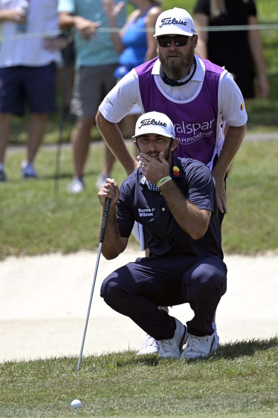 Max Homa, front, and his caddie line up a shot on the fringe of the first green during the final round of the Valspar Championship golf tournament, Sunday, May 2, 2021, in Palm Harbor, Fla. (AP Photo/Phelan M. Ebenhack)