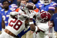 Florida tight end Kyle Pitts (84) misses the catch against Alabama's Josh Jobe (28) and Daniel Wright (3) during the second half of the Southeastern Conference championship NCAA college football game, Saturday, Dec. 19, 2020, in Atlanta. (AP Photo/John Bazemore)