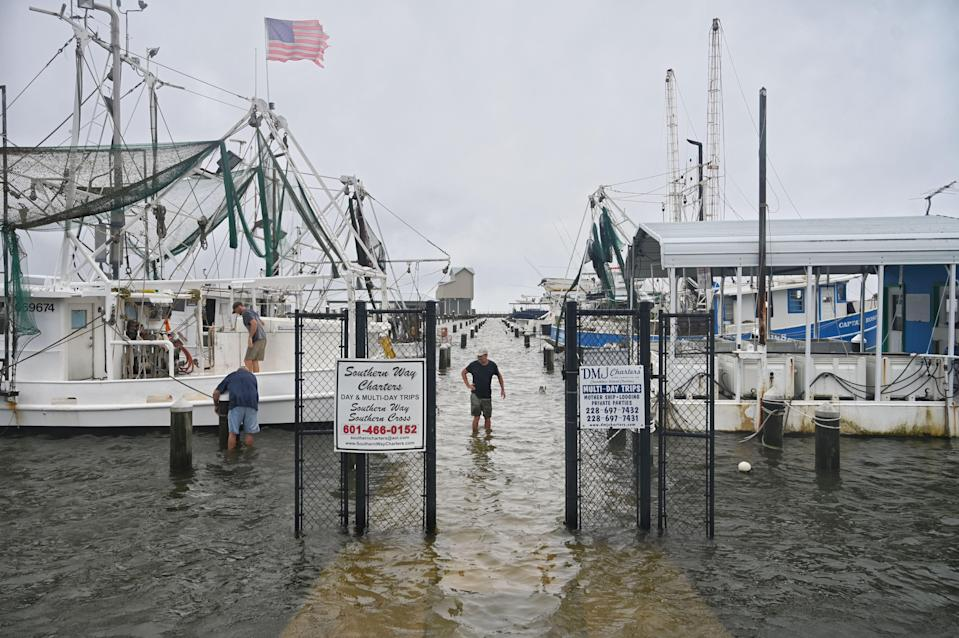 Fishermen secure their boats at Pass Christian Harbor in Mississippi in preparation for landfall of Tropical Storm Cristobal on June 7, 2020. The harbor was already flooded by storm surge.
