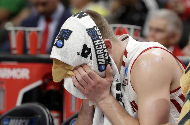 Wisconsin guard Brad Davison sits on the bench with a towel over his face during the second half of a first-round game against Oregon in the NCAA mens college basketball tournament Friday, March 22, 2019, in San Jose, Calif. (AP Photo/Chris Carlson)
