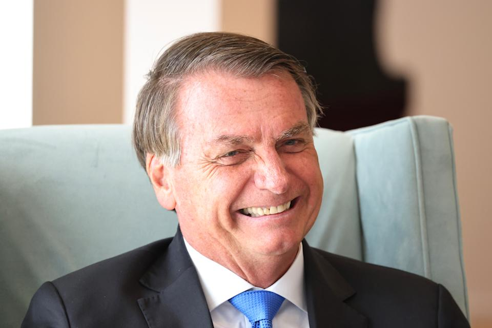 NEW YORK, NEW YORK - SEPTEMBER 20: Brazil's president Jair Bolsonaro laughs as he sits with British Prime Minister Boris Johnson for a bilateral meeting at the UK diplomatic residence on September 20, 2021 in New York City. The British prime minister is one of more than 100 heads of state or government to attend the 76th session of the UN General Assembly in person, although the size of delegations are smaller due to the Covid-19 pandemic. (Photo by Michael M. Santiago-Pool/Getty Images)