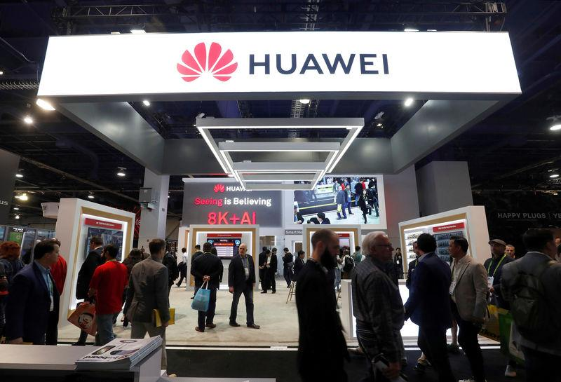 FILE PHOTO: Attendees pass by a Huawei booth during the 2019 CES in Las Vegas