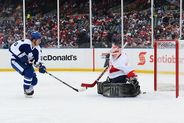 DETROIT, MI - DECEMBER 31: Todd Warriner #8 of the Toronto Maple Leafs scores a first period goal on goaltender Kevin Hodson #31 of the Detroit Red Wings during the 2013 Hockeytown Winter Festival Alumni Showdown on December 31, 2013 at Comerica Park in Detroit, Michigan. (Photo by Jamie Sabau/Getty Images)