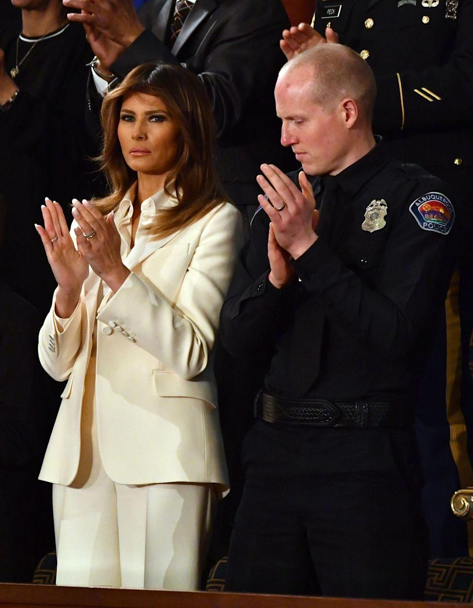 "<p>At President Trump's first State of the Union address in January 2018, Melania Trump wore a <a href=""https://www.glamour.com/story/melania-trump-all-white-suit-for-the-state-of-the-union"" rel=""nofollow noopener"" target=""_blank"" data-ylk=""slk:tailored white Christian Dior pantsuit"" class=""link rapid-noclick-resp"">tailored white Christian Dior pantsuit</a> and a Dolce & Gabbana blouse. Many people thought this was <a href=""https://www.vanityfair.com/style/2018/01/melania-trump-state-of-the-union-white"" rel=""nofollow noopener"" target=""_blank"" data-ylk=""slk:a nod"" class=""link rapid-noclick-resp"">a nod</a> to Hillary Clinton and the Democratic women <a href=""https://www.cnn.com/2017/02/28/politics/democratic-women-wear-white-donald-trump-speech/index.html"" rel=""nofollow noopener"" target=""_blank"" data-ylk=""slk:who wore white"" class=""link rapid-noclick-resp"">who wore white</a> to the presidential address in 2017 to pay homage to the suffragette movement and women's rights. </p>"