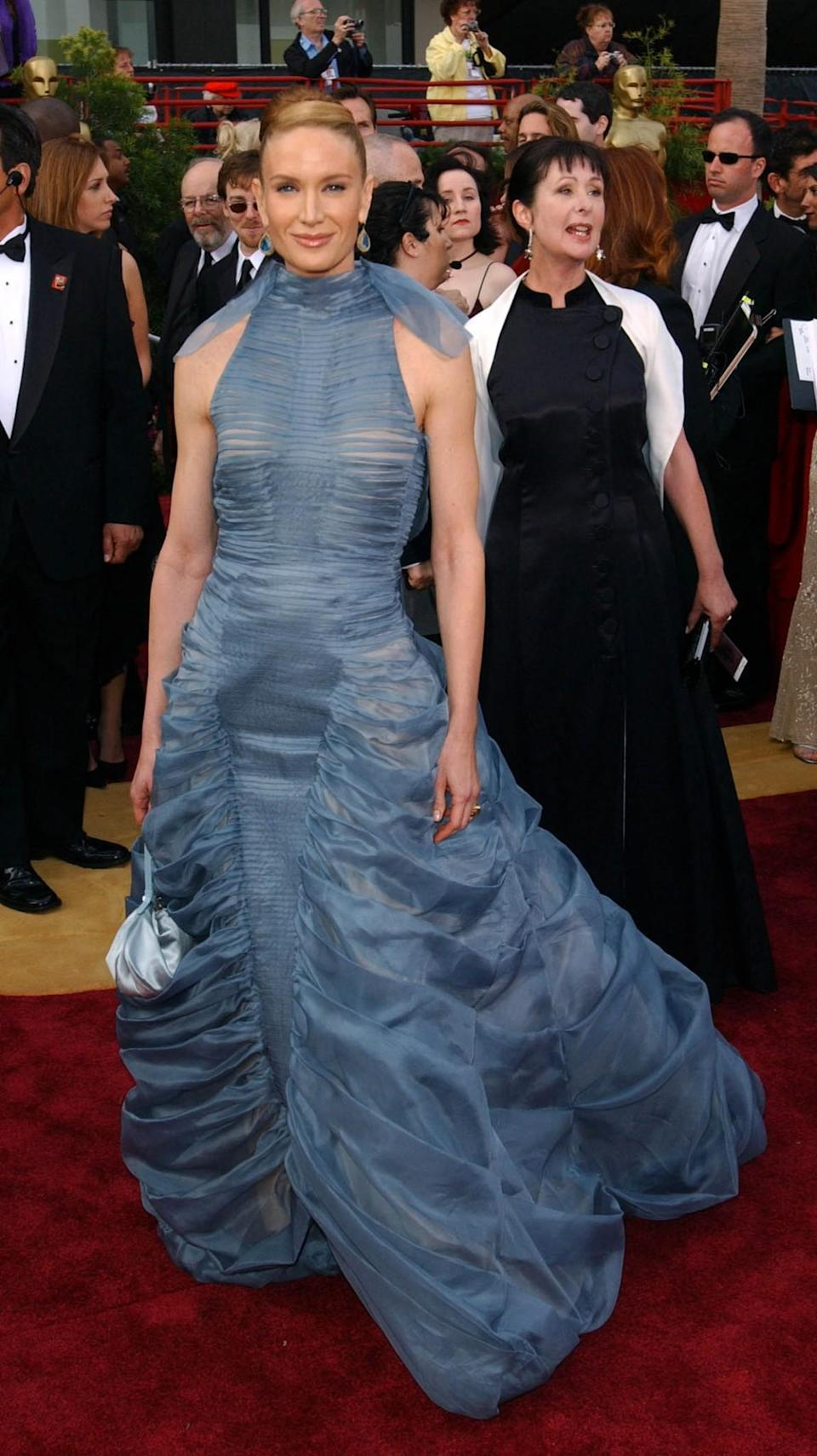 <p>We're totally on board with the colour of Lynch's 2004 frock – if only it had about four metres less fabric. <em>[Photo: PA]</em> </p>