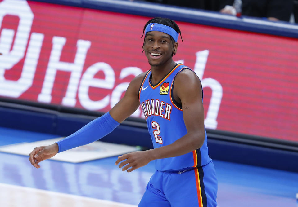 Feb 22, 2021; Oklahoma City, Oklahoma, USA; Oklahoma City Thunder guard Shai Gilgeous-Alexander (2) reacts after a shot against the Miami Heat during the first quarter at Chesapeake Energy Arena.