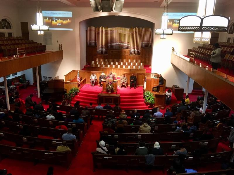 """A crowd gathers at 16th Street Baptist Church in Birmingham, Ala., Tuesday, Nov. 27, 2018, for a community vigil regarding the shooting death of Emantic """"EJ"""" Bradford Jr., a black man by police in a shopping mall on Thanksgiving. Bradford's mother said Tuesday that she believes her son would still be alive had he been white. (AP Photo/Jay Reeves)"""