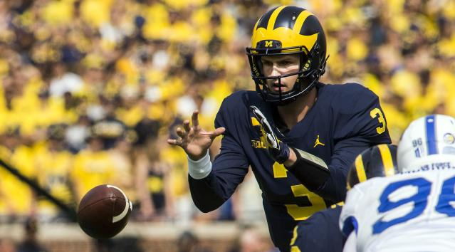 Wilton Speight takes a snap in the first quarter of an NCAA college football game against Air Force in Ann Arbor, Mich., Saturday, Sept. 16, 2017. (AP Photo/Tony Ding)