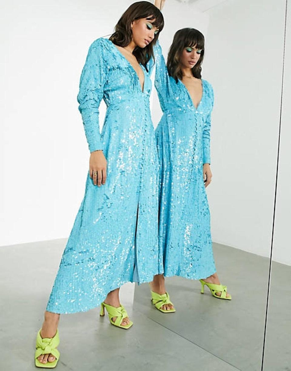 """Nothing like a shimmering tea dress to command the dance floor—after the bride and groom have their moment, of course. $256, Asos. <a href=""""https://www.asos.com/us/asos-edition/asos-edition-button-through-midi-tea-dress-in-sequin/prd/14162326"""" rel=""""nofollow noopener"""" target=""""_blank"""" data-ylk=""""slk:Get it now!"""" class=""""link rapid-noclick-resp"""">Get it now!</a>"""
