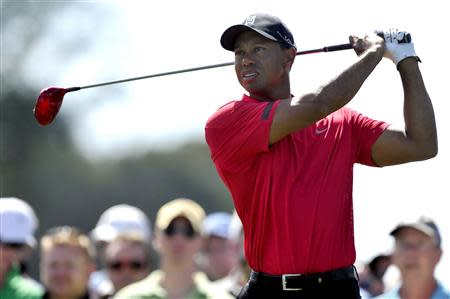 Mar 2, 2014; Palm Beach Gardens, FL, USA; Tiger Woods drives on nine during the final round of The Honda Classic golf tournament at PGA National GC Champion Course. Mandatory Credit: Brad Barr-USA TODAY Sports