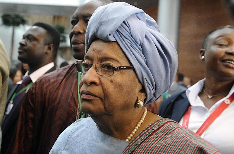 Liberian President Ellen Johnson Sirleaf arrives on the second day of the 50th African Union Aniversary Summit in Addis Ababa, May 26, 2013 (AFP Photo/Simon Maina)