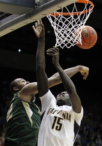 South Florida forward Toarlyn Fitzpatrick blocks a shot by California forward Bak Bak (15) in the first half of an NCAA tournament first-round college basketball game, Wednesday, March 14, 2012, in Dayton, Ohio. (AP Photo/Skip Peterson)