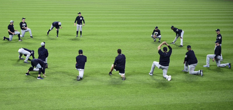 The New York Yankees stretch during a team workout Wednesday, Oct. 4, 2017, in Cleveland. The Yankees are scheduled to play the Cleveland Indians in Game 1 of am ALDS on Thursday. (AP Photo/David Dermer)