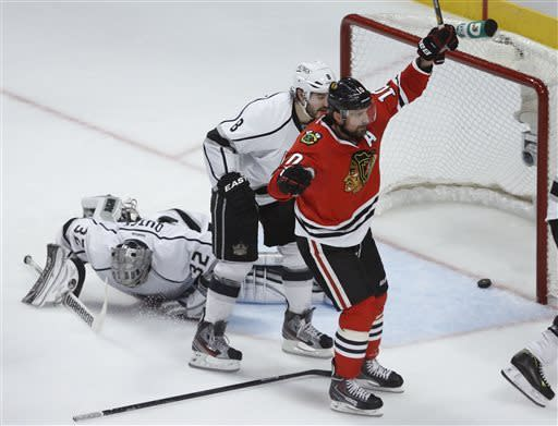 Chicago Blackhawks center Patrick Sharp (10) reacts after scoring a goal against Los Angeles Kings goalie Jonathan Quick (32) during the second period in Game 1 of the NHL hockey Stanley Cup Western Conference finals Saturday, June 1, 2013, in Chicago. (AP Photo/Charles Rex Arbogast)