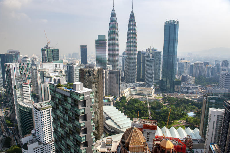 KUALA LUMPUR, FEDERAL TERRITORY OF KUALA LUMPUR, MALAYSIA - 2018/07/27: The view over Kuala Lumpur city center and the Petronas Twin Towers from the top of the Banyan Tree Hotel, Malaysia. (Photo by Leisa Tyler/LightRocket via Getty Images)