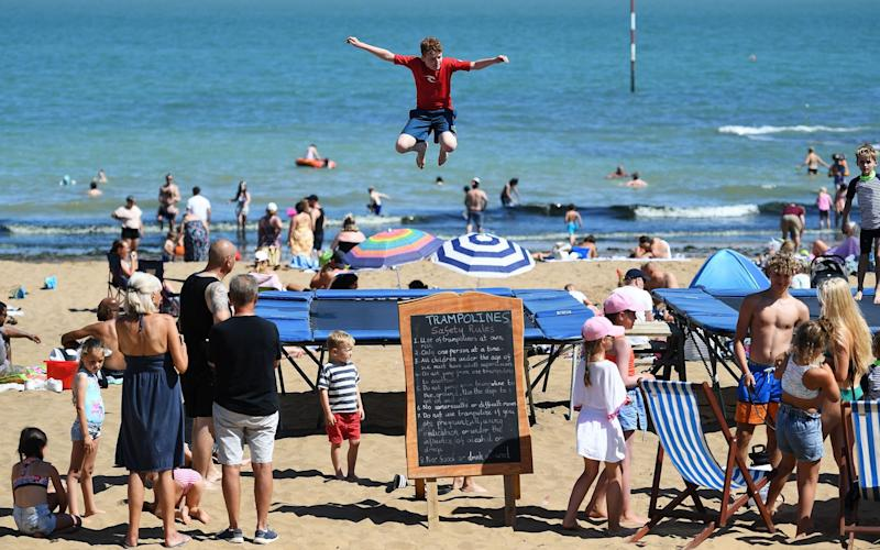 Children enjoy the trampolines at the beach at Broadstairs in Kent, Britain, 02 August 2020. Many Britons are choosing staycations over holidays abroad during the Coronavirus pandemic. - Andy Rain/EPA-EFE/Shutterstock