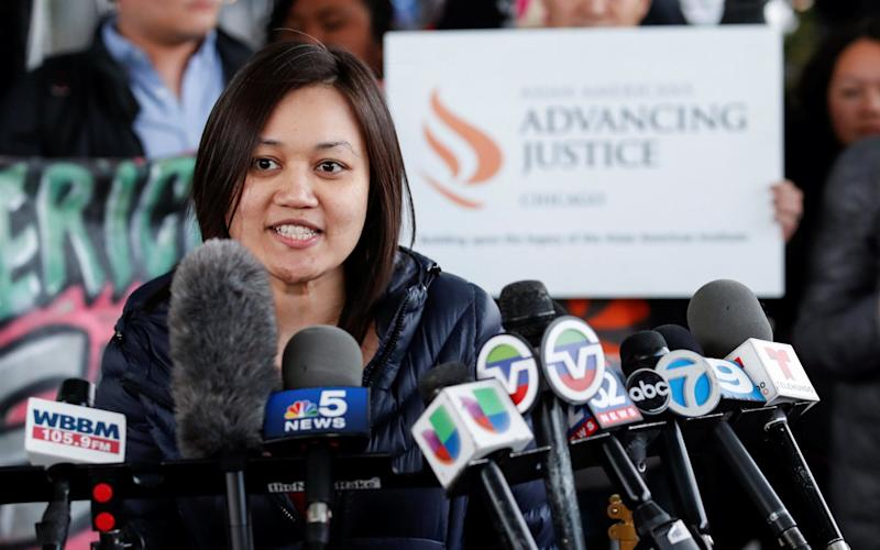 Tuyet M. Le, Executive Director of Asian American Advancing Justice, speaks during a protest of the treatment of Dr. David Dao - Credit: Kamil Krzaczynski/Reuters